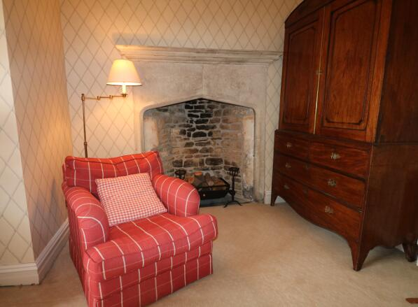 Yate room comfortable chair and feature fireplace